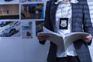 Image of police detective for our FAQ about what you can do with an online PhD in criminal justice